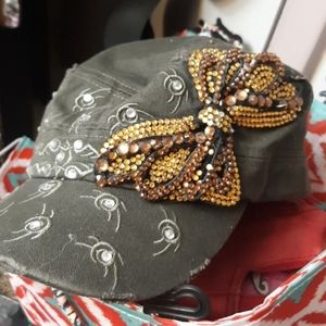 green distressed beaded hat